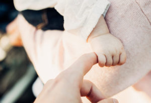 Baby grabbing parent's finger